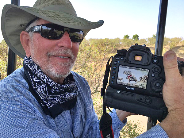 Safari photographer shows off his photo of the wildebeest crossing the Mara River in East Africa